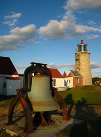 Historic lighthouse and bell Photo by Kim Schutsky